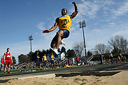 """Wilmington's Chris Burns almost sets a new school record in the long jump at the Wilmington Relays with a leap of 22' 1 1/4""""."""