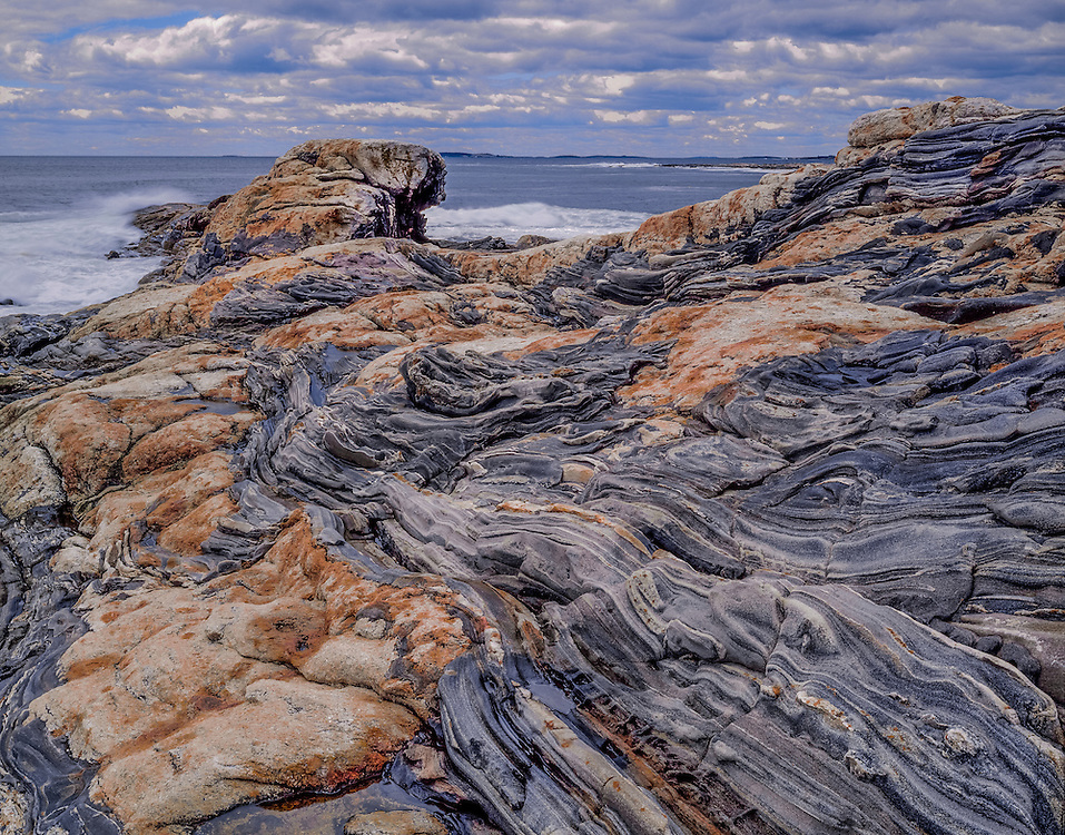 Strata layers of rock, curving lines and mixed rock types, with surf, Pemaquid Point, Bristol, ME