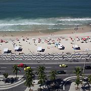 Praia de Copacabana. Copacabana beach, one of the world's most famous urban beaches. The beach and hotel strip stretches for 1.5 miles (4km) from the Morro do Leme at the Northern end, to Arpoador. Copacabana beach, Rio de Janeiro,  Brazil. 20th July 2010. Photo Tim Clayton..
