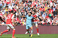 Sergio Aguero of Manchester city © reacts as he takes a knock from Laurent Koscielny of Arsenal (r) .The Emirates FA Cup semi-final match, Arsenal v Manchester city at Wembley Stadium in London on Sunday 23rd April 2017.<br /> pic by Andrew Orchard,  Andrew Orchard sports photography.