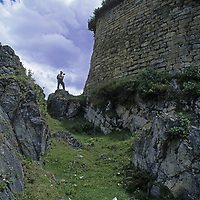 A traveler in Peru's Cordillera Central approaches the imposing fortress walls at Kuelap, a stronghold of the pre-Incan Chachapoyan culture.