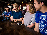 17 APRIL 2019 - DES MOINES, IOWA: US Senator KIRSTEN GILLIBRAND (D-NY), left, talks to Drake University students during a meet and greet with the students at a restaurant in Des Moines. Gillibrand is touring Iowa this week to support her candidacy to be the Democratic nominee for the US Presidency. Iowa traditionally hosts the the first selection event of the presidential election cycle. The Iowa Caucuses will be on Feb. 3, 2020.              PHOTO BY JACK KURTZ