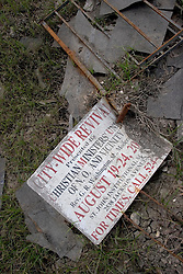 01 October, 05.  New Orleans, Louisiana. Lower 9th ward. Hurricane Katrina aftermath. <br /> The remnants of the lives of ordinary folks, now covered in mud as the flood waters recede.A church sign for Christian Ministries' City Wide Revival lies in the mud.<br /> Photo; ©Charlie Varley/varleypix.com