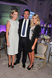 Left to right, KENNY & GABBY LOGAN and MOLLIE KING at the Dyslexia Action Awards Dinner at The Savoy Hotel, London on 29th November 2012.