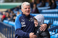 AFC Wimbledon manager Glyn Hodges hugging fan during the EFL Sky Bet League 1 match between AFC Wimbledon and Lincoln City at the Cherry Red Records Stadium, Kingston, England on 2 November 2019.