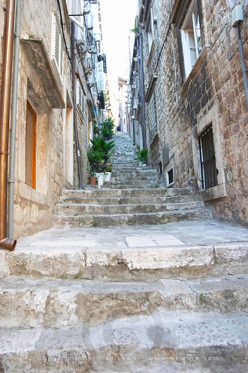View from the Prijeko street up a narrow street with steep stairs. Narrow cobble stone street. Dubrovnik, old city. Dalmatian Coast, Croatia, Europe.