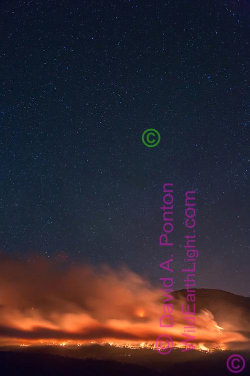 Thompson Fire burning west of Redondo Peak on the night of June 1, 2013. Valles Caldera National Preserve, New Mexico, © 2013 David A. Ponton
