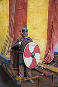 A model viking, with viking ship, at Dublinia on 07th April 2017 in Dublin, Republic of Ireland. Dublinia is a historical recreation museum and visitor attraction, focusing on the Viking and medieval history of the city. The museum is located in a part of Dublins Christ Church Cathedral, known as the Synod hall. Dublin is the largest city and capital of the Republic of Ireland.