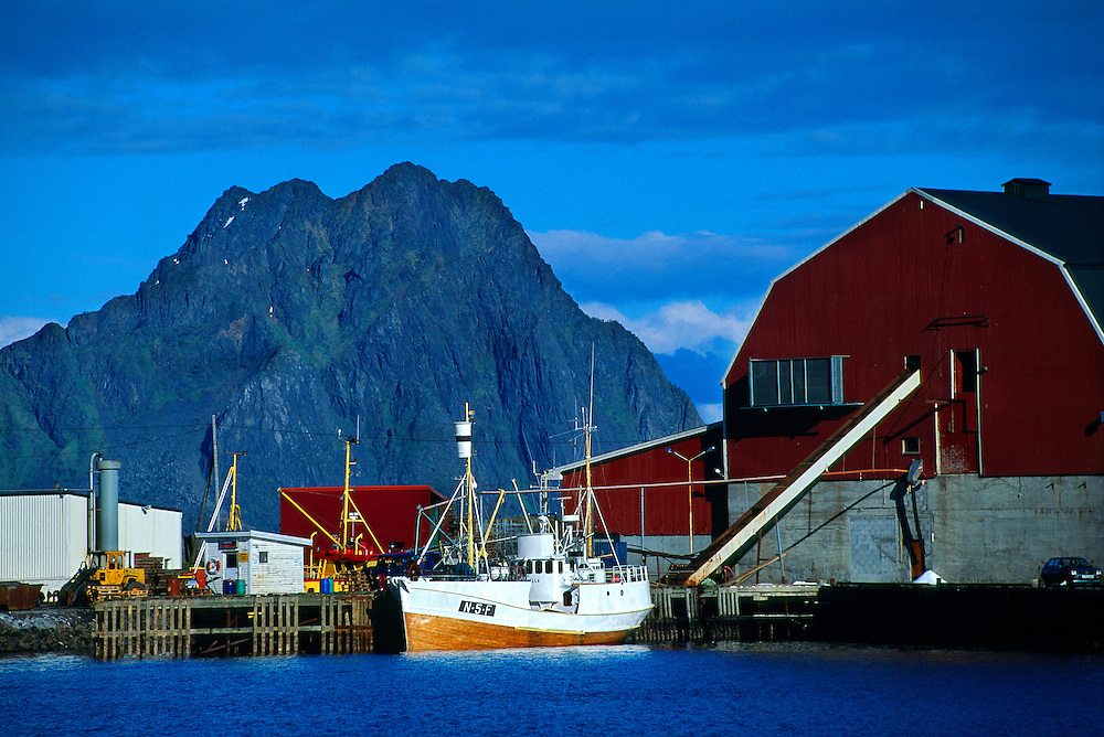 Fishing boat and docks in the harbor of Svolvaer, Lofoten Islands, Arctic, Northern Norway