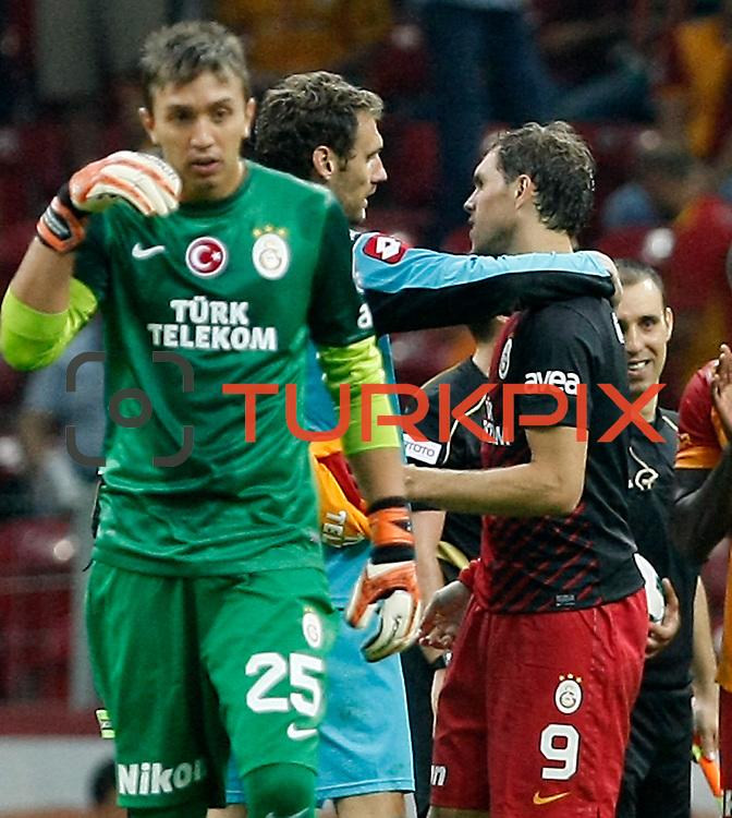 Galatasaray's Johan Elmander (R) and Kasimpasa's (L) during their Turkish Super League soccer match Galatasaray between Kasimpasa at the TT Arena at Seyrantepe in Istanbul Turkey on Monday 20 August 2012. Photo by TURKPIX