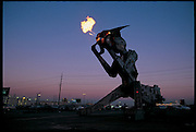 Robosaurus prowls the parking lot of a Las Vegas, NM, casino, showing off its ability to breathe fire and crush cars in its mighty claws. The machine can be rented as a destructive attraction for car and air shows. Like a huge transformer toy, Robosaurus folds itself into a tractor trailer that is pulled by a large truck. From the book Robo sapiens: Evolution of a New Species, pages 10-11.