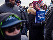"10 DECEMBER 2019 - DES MOINES, IOWA: Supporters of Andrew Yang wait in the cold in front of the Iowa State Capitol for Yang to arrive at the kickoff of his bus tour. The temperature at the time was about 20F. Yang's supporters frequently wear hats with MATH embroidered on them. MATH is one of the slogans of his campaign and stands for ""Make America Think Harder."" Yang, an entrepreneur, is running for the Democratic nomination for the US Presidency in 2020. He kicked off a five day bus tour today at the Iowa State Capitol in Des Moines. Iowa hosts the the first election event of the presidential election cycle. The Iowa Caucuses will be on Feb. 3, 2020.                 PHOTO BY JACK KURTZ"