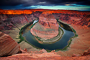 The Colorado River makes a dramatic, almost circular bend at Horseshoe Bend, south of Page, Arizona, in the Glen Canyon National Recreation Area. The towering red cliffs are about 1,000 feet (305 meters) above the river.