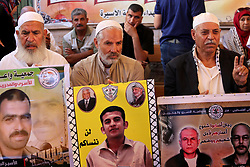 June 15, 2017 - Gaza City, Gaza Strip, Palestinian Territory - Palestinians take part in a protest to show solidarity with Palestinian prisoners held in Israeli jails, in front of Red cross office in Gaza city on June 12, 2017  (Credit Image: © Mohammed Asad/APA Images via ZUMA Wire)