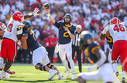 Sep 4, 2021; College Park, Maryland, USA; West Virginia Mountaineers quarterback Jarret Doege (2) throws a pass to West Virginia Mountaineers wide receiver Winston Wright Jr. (1) during the second quarter against the Maryland Terrapins at Capital One Field at Maryland Stadium. Mandatory Credit: Ben Queen-USA TODAY Sports