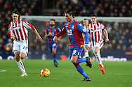 Marouane Chamakh of Crystal Palace makes a break.Barclays Premier league match, Stoke city v Crystal Palace at the Britannia Stadium in Stoke on Trent, Staffs on Saturday 19th December 2015.<br /> pic by Andrew Orchard, Andrew Orchard sports photography.