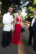 THOMAS BIRKETT; NATHALIE HARRISON, Richard Taylor's 69th birthday party.  Whithurst Park. West Sussex.  3 August 2013