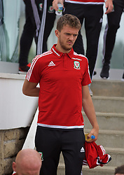 DINARD, FRANCE - Tuesday, June 7, 2016: Wales' Emyr Huws makes his way down a staircase for a team group photograph at the Novotel Thalasso Dinard ahead of the start of the UEFA Euro 2016 tournament. (Pic by Paul Greenwood/Propaganda)