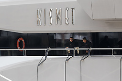 © Licensed to London News Pictures. 01/10/2016. LONDON, UK.  Two men polish superyacht Kismet. Kismet' arrived in London and moored at Butlers Wharf on the River Thames earlier this week, but the silver Jaguar was not fitted on its arrival. Kismet is 308 feet long and is reportedly owned by Pakistani-American billionaire Shahid Khan. Mr Khan owns the National Football League (NFL) team, the Jacksonville Jaguars, who are due to play the Colts in an International Series game at Wembley tomorrow. Kismet has 6 staterooms, with the master bedroom having its own private deck with jacuzzi and helipad and can be chartered for an estimated £1m per week.  Photo credit: Vickie Flores/LNP