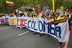 SOS Colombia activists march with an International Bloc to highlight human rights abuses taking place in Colombia on the National Demonstration for Palestine on 22nd May 2021 in London, United Kingdom. The demonstration was organised by pro-Palestinian solidarity groups in protest against Israel's recent attacks on Gaza, its incursions at the Al-Aqsa mosque and its attempts to forcibly displace Palestinian families from the Sheikh Jarrah neighbourhood of East Jerusalem.