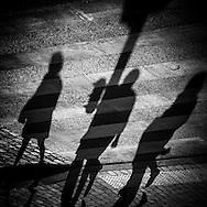 France Paris- le marais, Shadows of two pedestrians in a street of Paris