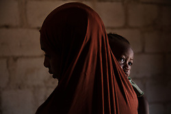 Aisha, 15, holds her one year old daughter Hadiza, who was born in captivity. Boko Haram, a militant Islamist group, began it's insurgency against the Nigerian government in 2009. The terrorist group drew global outrage after abducting more than 270 schoolgirls from the town of Chibok. Many of the girls were forced into marriage and motherhood. The Borno State National Emergency Agency estimates tens of thousands more women and girls have also been kidnapped by militants in less-publicized attacks. In armed conflicts, child marriage is increasingly used as a weapon of war, forcing girls to give birth give birth to the next germination of fighters. Thousands of girls remain missing in Nigeria with little help of rescue. Those who manage to escape struggle with little support to rebuild their lives.