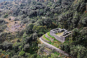 A small ruin in the jungle visible from the larger complex of Sayaqmarka along the Inca Trail to Machu Picchu, Peru on September 20, 2005.