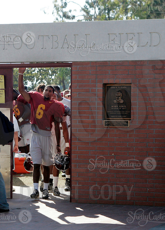 16 August 2006: Antwine Perez (6) taps the entryway to the football field, the Goux gate, a legendary superstition for the USC Trojans Pac-10 college football team summer practice at Howard Jones Field on campus in Los Angeles, CA.
