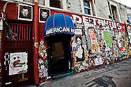 Street art in Los Angeles..L.A. has become the new ground zero for avant-guard and cutting edge street and graffiti. Artist from around the world now come to L.A. to post their work..The American Hotel is a popular location for street artist to paste up in downtown L.A.