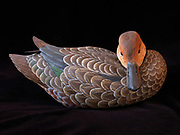 Decorative decoy of a hen blue-winged teal hand carved from basswood by Lee Suydam.