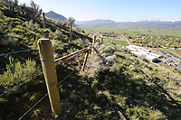 Fence blocking trail to top of Antelope Butte (High School Butte) in Jackson, Wyo.