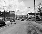 Ackroyd 02095-2looking west on N. Broadway showing intersection of Vancouver. March 28, 1950. The large building on the left with the Plymouth billboard was the Dude Ranch. Portland, Oregon.