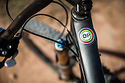 SHOT 10/14/16 12:27:25 PM - A sticker commemorating the life of photographer Doug Pensinger on Marc Piscotty's bike. The White Rim is a mountain biking trip in Canyonlands National Park just outside of Moab, Utah. The White Rim Road is a 71.2-mile-long unpaved four-wheel drive road that traverses the top of the White Rim Sandstone formation below the Island in the Sky mesa of Canyonlands National Park in southern Utah in the United States. The road was constructed in the 1950s by the Atomic Energy Commission to provide access for individual prospectors intent on mining uranium deposits for use in nuclear weapons production during the Cold War. Four-wheel drive vehicles and mountain bikes are the most common modes of transport though horseback riding and hiking are also permitted.<br /> (Photo by Marc Piscotty / © 2016)