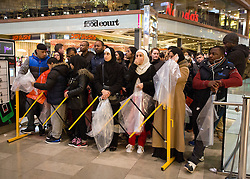 © Licensed to London News Pictures. 26/12/2014. Shoppers queue outside Next, in Westfield Stratford City, east London, in the early hours of Boxing Day (26/12/2014.). Photo credit : LNP