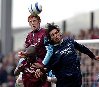 Photo: Daniel Hambury.<br />West Ham United v Manchester City. The Barclays Premiership. 15/04/2006.<br />West Ham's James Collins (top) and Shaun Newton combine to stop City's Georgios Samaras.