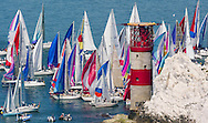 Competitors racing in the 75th JPMorgan Asset Management Round The Island Race bunch up at The Needles lighthouse on the western tip of the Isle of Wight as the winds drop and the tide slackens.