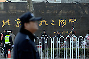 BEIJING, CHINA - MARCH 21: (CHINA OUT) <br /> <br /> U.S. First Lady Visits Beijing School <br /> <br /> Police officers stand guard at the entrance of The Second High School Attached to Beijing Normal University as US First Lady Michelle Obama visits the school on March 21, 2014 in Beijing, China. U.S. First Lady Michelle Obama arrived in Beijing on Thursday afternoon, kicking off her seven-day visit to China, at the invitation of Peng Liyuan, wife of Chinese President Xi Jinping.<br /> ©Exclusivepix