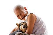 92 year old, Huong Phung shares a smile with a Chua Dieu Vien Pagoda community dog, Hue, Vietnam.  Photo by Stan Olszewski/SOSKIphoto