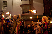 People parading dressed as red indians native Americans with flaming torches, at the annual Lewes Bonfires procession and bonfire events in Lewes, East Sussex, UK, on November the 5th are the largest celebrations of this kind, marking Guy Fawkes night, the tradition in Lewes comes from Christian martyrs and can be traced back centuries.