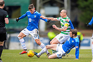 Murray Davidson (#8) of St Johnstone FC and Ross Callaghan (#28) of St Johnstone FC tackle Scott Brown (#8) of Celtic FC  during the Ladbrokes Scottish Premiership match between St Johnstone and Celtic FC at McDiarmid Park, Perth, Scotland on 3 February 2019.