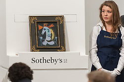 © Licensed to London News Pictures. 19/06/2018. LONDON, UK. ''Tête De Femme Au Chapeau Orange'' by Pablo Picasso, (Est. £4,000,000 - 6,000,000) sold for a hammer price of£4,200,000 at Sotheby's Impressionist & Modern art evening sale in New Bond Street.  Photo credit: Stephen Chung/LNP
