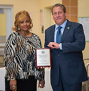 Cynthia Smith, left, receives the Business Operations Employee of the Year award from Chief Robert Mock, right, during the Houston ISD Police awards banquet at Thompson Elementary School, August 15, 2014.
