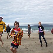 Will Genia, Luke Burgess and Berrick Barnes, playing rugby with locals during the Australian teams recovery session at  Takapuna Beach at the IRB Rugby World Cup tournament, Auckland, New Zealand, 17th October 2011. Photo Tim Clayton...