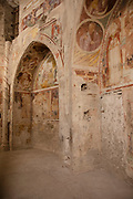 Interior showing ancient frescoes in Spoleto Cathedral in Spoleto, Umbria, Italy. Cattedrale di Santa Maria Assunta, or Duomo di Spoleto is the cathedral of the Archdiocese of Spoleto-Norcia created in 1821. The church is essentially an example of Romanesque architecture.