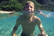 Boy swimming, Hawaii<br />