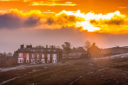© Licensed to London News Pictures. 24/01/2019. Ilkley UK. The Cow & Calf pub on Ilkley Moor at sunrise this morning in Yorkshire. Photo credit: Andrew McCaren/LNP