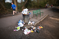 © Licensed to London News Pictures. 31/03/2021. Manchester, UK. More rubbish than is usual is seen in and around a bin in Heaton Park following a day of warm weather and the easing of Coronavirus restrictions . Photo credit: Joel Goodman/LNP