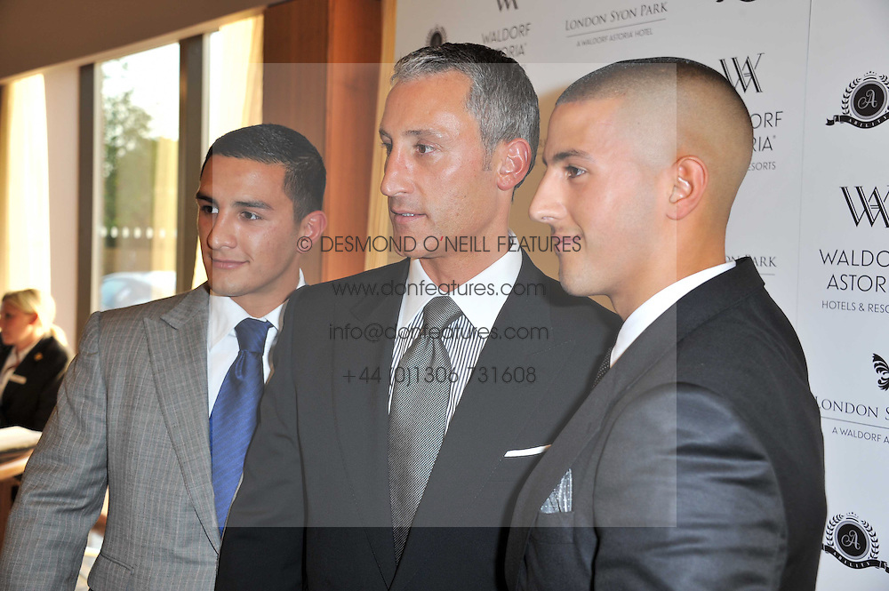 Left to right, COSTAS PANAYIOTOU, ANDREAS PANAYIOTOU and GEORGE PANAYIOTOU at the opening party of the London Syon Park - A Waldorf Astoria Hotel, Syon Park, Middlesex on 19th May 2011.