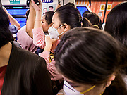 31 JANUARY 2019 - BANGKOK, THAILAND:   Passengers on the BTS Skytrain wearing breathing masks to filter out the air pollution in Bangkok. The Thai government has closed more than 400 schools for the rest of the week because of high levels of pollution in Bangkok. At one point Wednesday, Bangkok had the third highest level of air pollution in the world, only Delhi, India and Lahore, Pakistan were worst. The Thai government has suspended some government construction projects and ordered other projects to take dust abatement measures. Bangkok authorities have also sprayed water into the air in especially polluted intersections to control dust. Bangkok's AQI (Air Quality Index) Thursday morning was 180, which is considered unhealthy for all people.      PHOTO BY JACK KURTZ