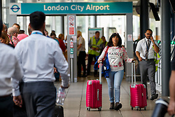 © Licensed to London News Pictures. 06/09/2016. London, UK. Passengers are stranded at London City Airport in east London as protestors from the Black Lives Matter group block the runway at London City Airport. All flights in and out of the airport are disrupted. Photo credit: Tolga Akmen/LNP